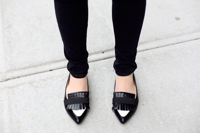 black and white pointy flats